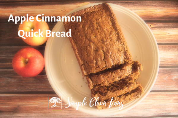 "Picture of a loaf of sliced bread on a plate and the blog post title ""Apple Cinnamon Quick Bread"""