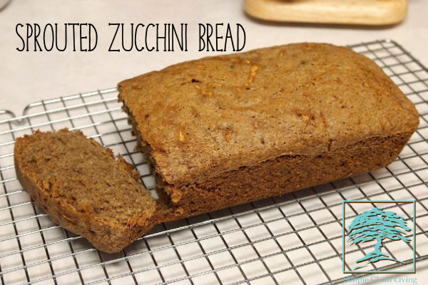A fresh loaf of sprouted zucchini bread on a cooling rack