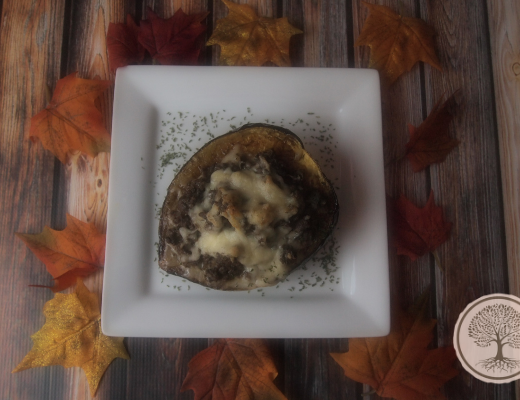 Picture of a white plate with a stuffed acorn squash on it and a recipe name overlay