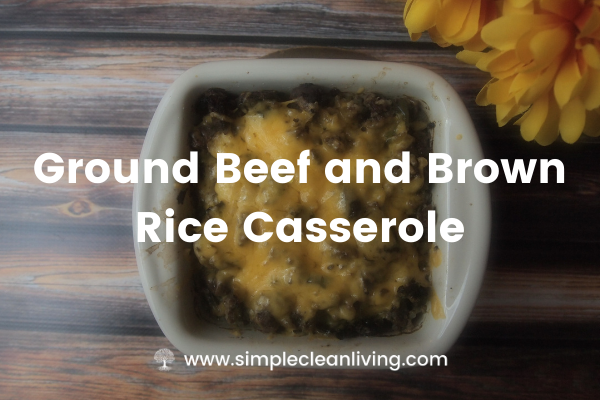 a baking dish with ground beef and brown rice casserole topped with cheese