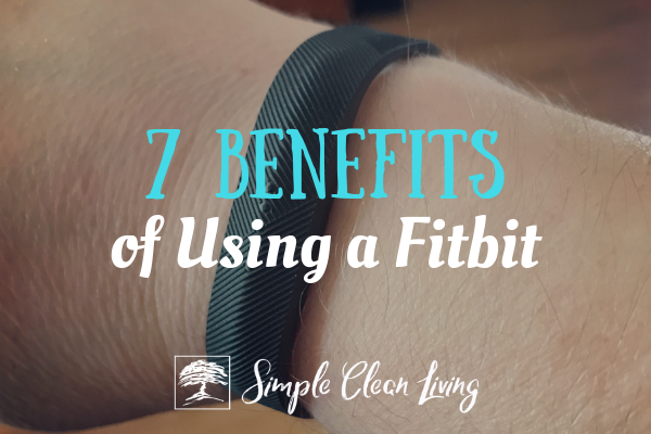 "A picture of a wrist wearing a Fitbit with the blog post title ""7 Benefits of using a Fitbit"""