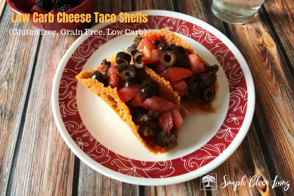 "A picture of two tacos on a plate with the blog post title ""Low Carb Cheese Taco Shells, gluten free, grain free, low carb"""