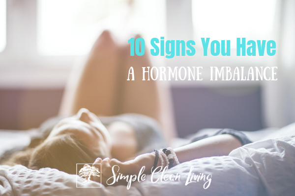 "Picture of a woman laying on the bed with the blog post title ""10 Signs You Have a Hormone Imbalance"""