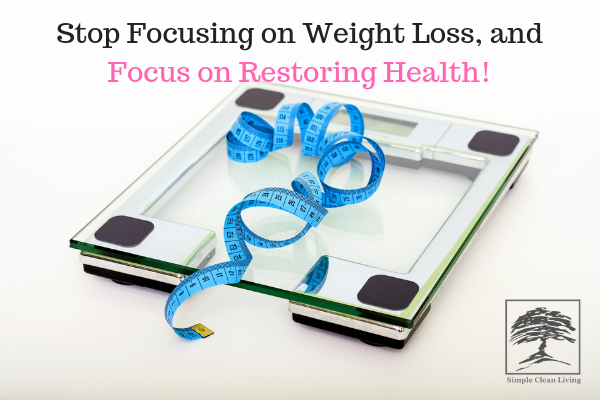 "A picture of a scale with a measuring tape on it with the blog post title ""Stop Focusing on Weight Loss, and Focus on Restoring Health"""