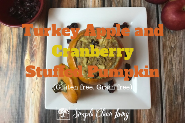 "A picture of a baked stuffed pumpkin with the blog post title ""Turkey, Apple and Cranberry Stuffed Pumpkin"""