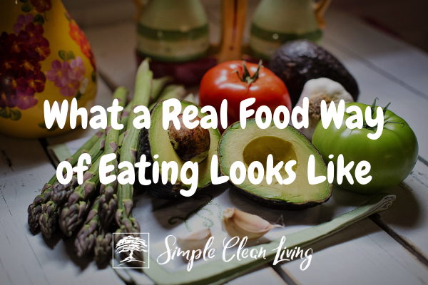 "A picture of different fruits and vegetables with the blog post title ""What a Real Food Way of Eating Looks Like"""