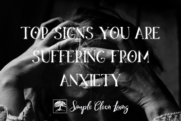 "Picture of an anxious woman with the blog post title ""Top Signs You Are Suffering from Anxiety"""