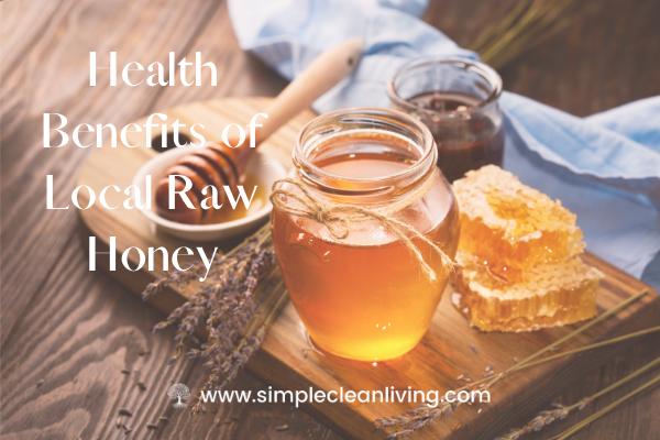 A jar of honey sitting on a cutting board